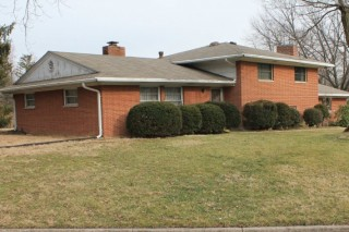 Great brick tri level lots of potential and nice yard.
