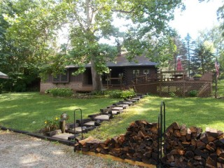 Log Home with park like setting on 1.25 acres