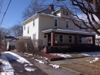 Public Real Estate Auction for Single family home with 4 bedrooms and an adjacent vacant buildable lot.